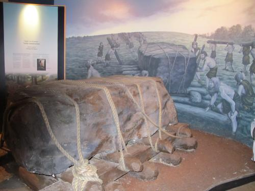 the stone block with logs in knowth's museum